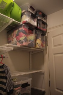 Since the door blocks this part (thanks, builders) we're storing outgrown clothes and baby stuff here