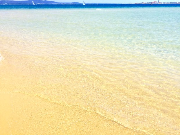 crystal clear water and white sands Algarve Portugal