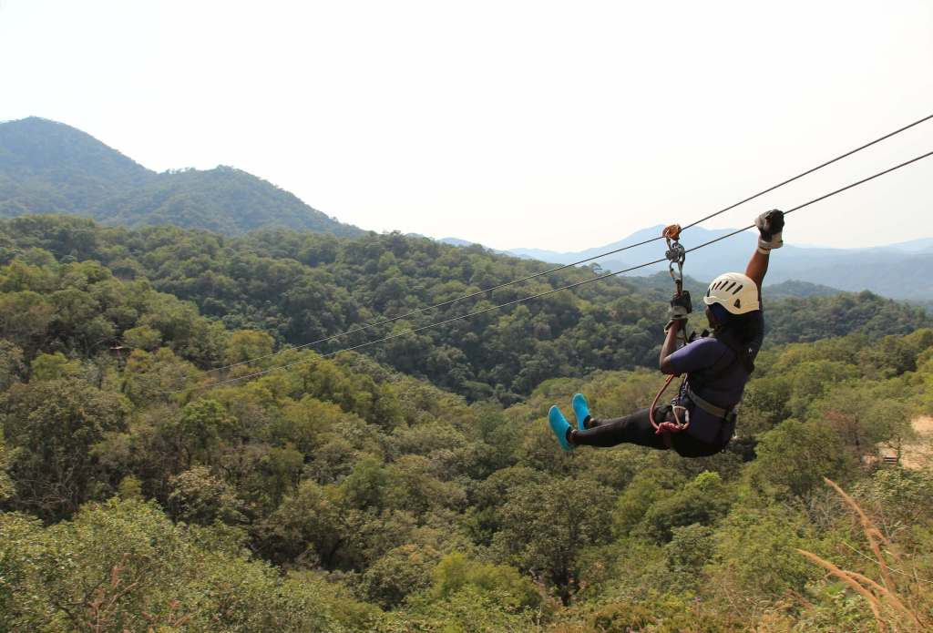 a person doing zip line