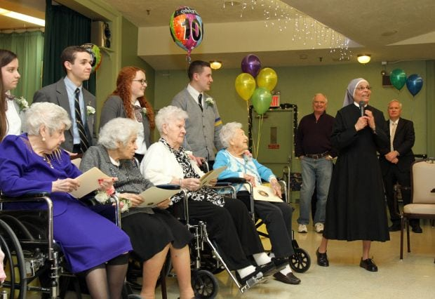 Mother Celine Therese Vadukkoot addresses guests during a birthday party for centenarians Jan. 20 at the Little Sisters of the Poor's Queen of Peace Residence in the Queens borough of New York. Eight residents celebrating 100 or more years in 2015 were honored at the event. (CNS photo/Gregory A. Shemitz)