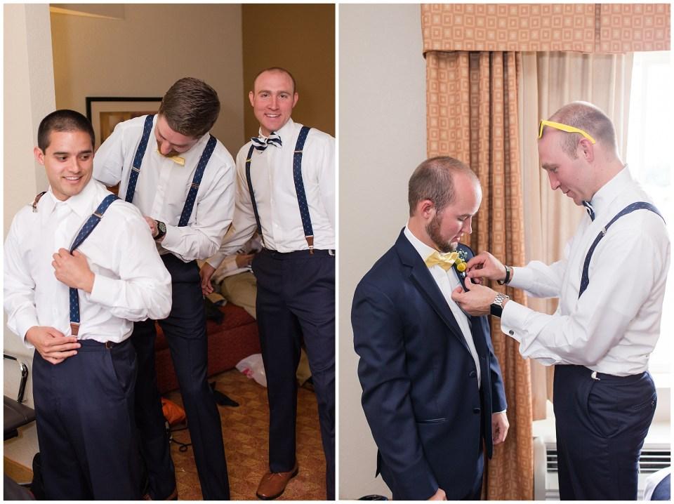 groom helping groomsmen get ready