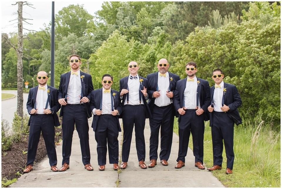 groomsmen wearing yellow sunglasses and suspenders