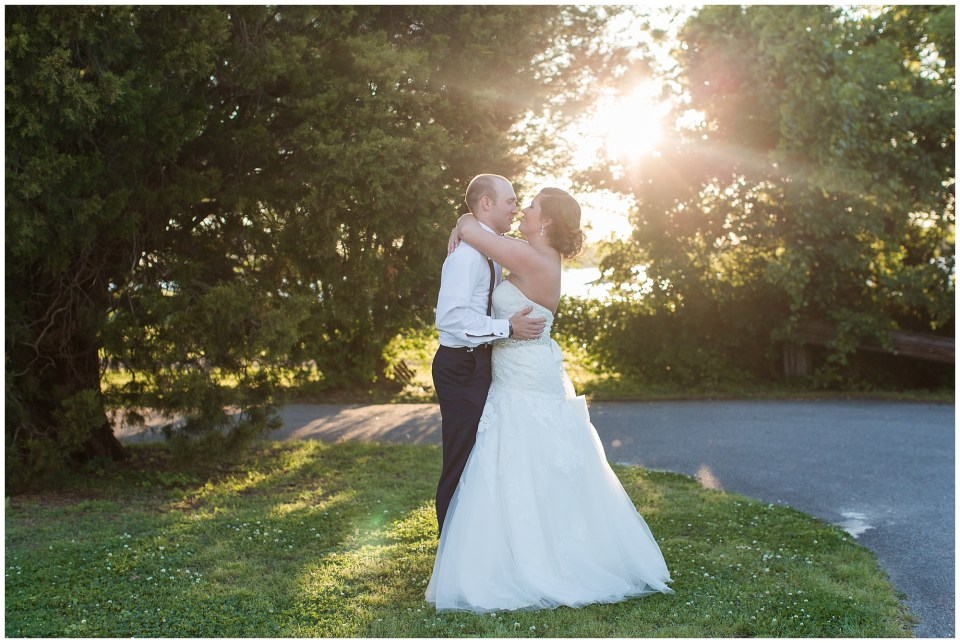 bride and groom hugging at sunset