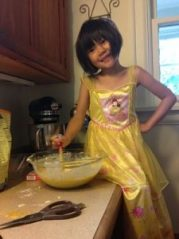Amelia making yellow birthday pancakes