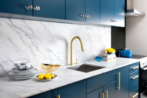 Installing Gold-toned Faucets and Fixture by Yanic Simard