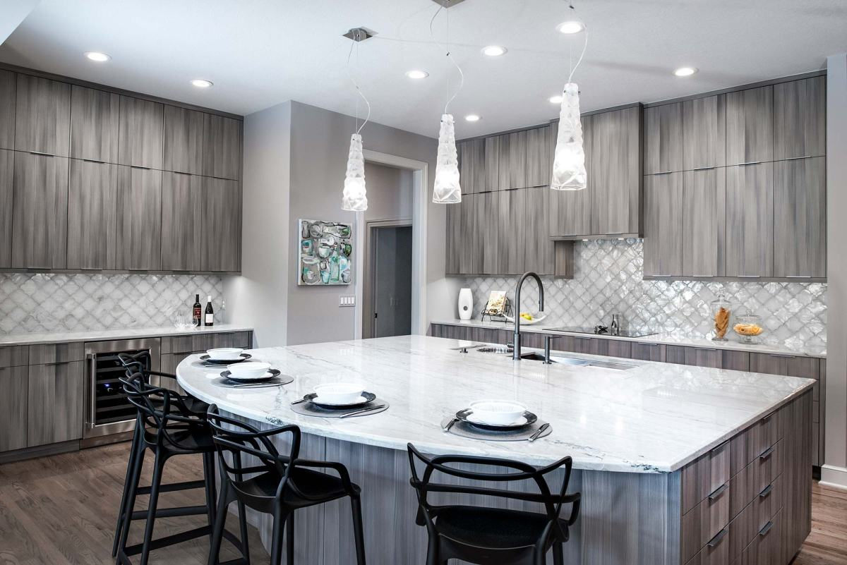 kitchen culinary-elegance-4-warm-transitional-open-kitchen-with-large-island-featuring-galley-workstation-beautiful-harmoni-cabinets-wood-floors-and-stainless-appliances