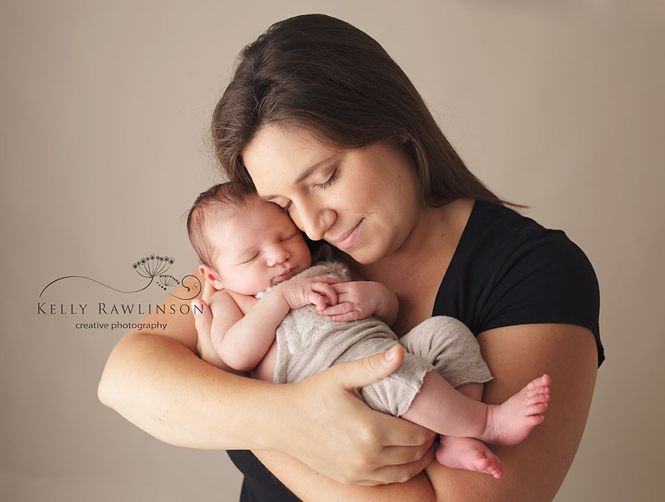 mom and baby, first family photograph, emotional family photos, newborn in mother's arms