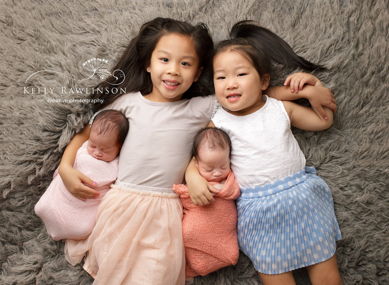 Aurora twin girls with older sisters