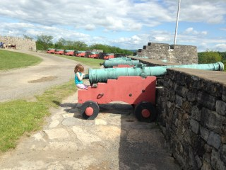 Rayleigh manning a cannon at Fort Ticonderoga.