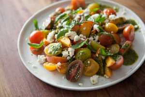 summer salad with peaches, tomatoes, and feta