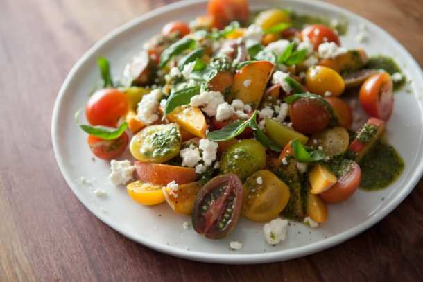 summertime salad with peaches, tomatoes, and feta
