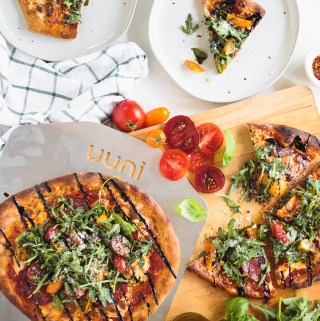Ooni Pizza with Sopressata, Arugula, & Balsamic Glaze