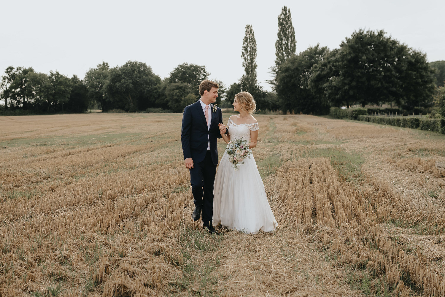 Image of a wedding taken by an Essex wedding photographer that has a fun and relaxed style photographing farm weddings in the Norfolk and Suffolk area.