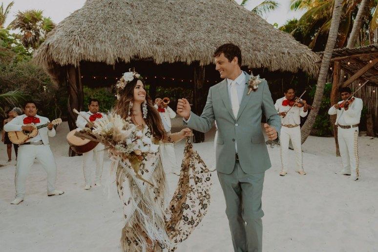 Bride and groom dance together in Tulum wedding as she wears rue de seine ziggy wedding dress