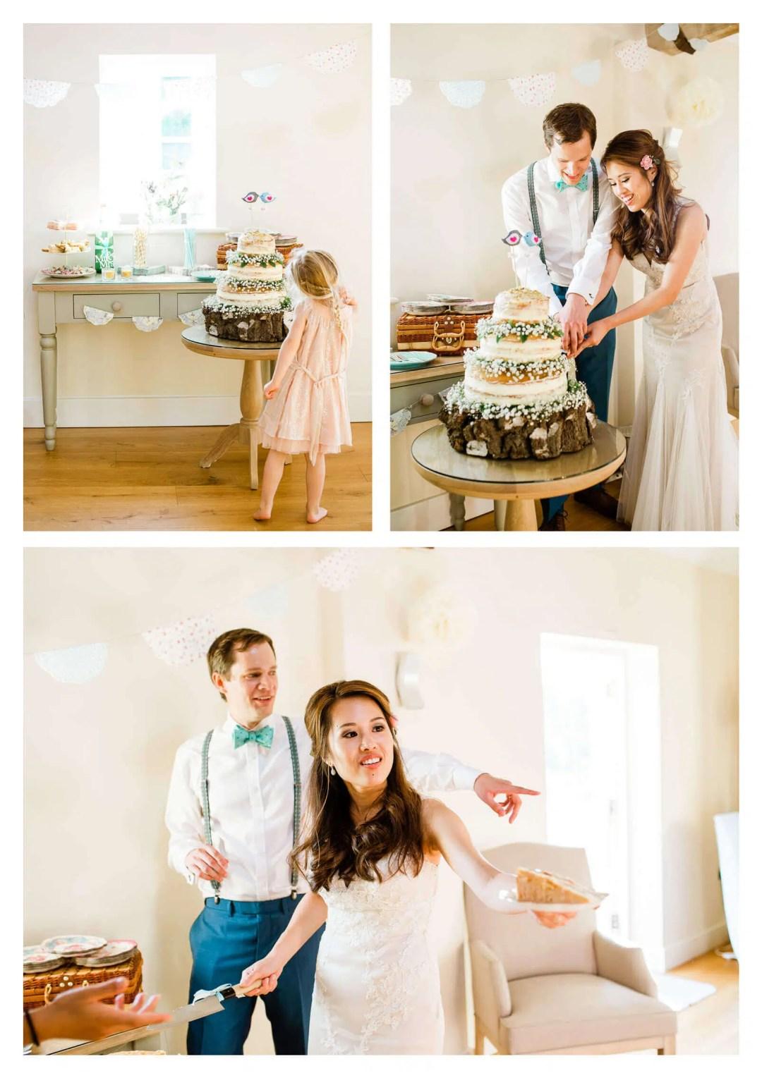 Finchcocks Oast wedding cake cutting made by groom | Kent wedding photographer