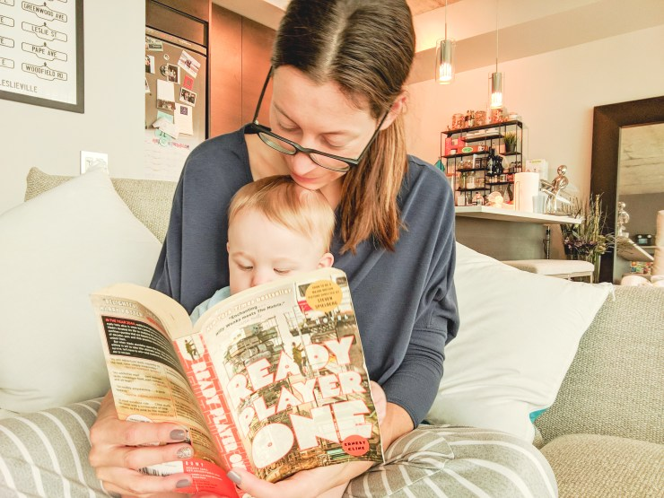 mom reading ready player one to her son