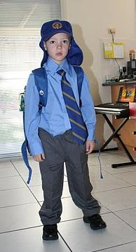 Tim in school uniform