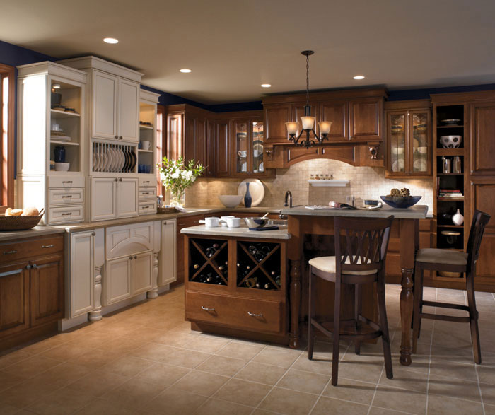 Cherry Wood Cabinets With A Two Level Kitchen Island By Kemper Cabinetry