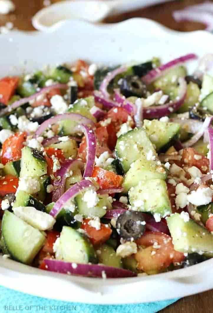 This chopped Cucumber Greek Salad and dressing recipe is light and refreshing, and full of healthy ingredients. With minimal prep, it makes an easy side dish for any meal! #vegetarian #healthy #kenarry