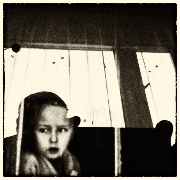 Stylized image of child looking out window