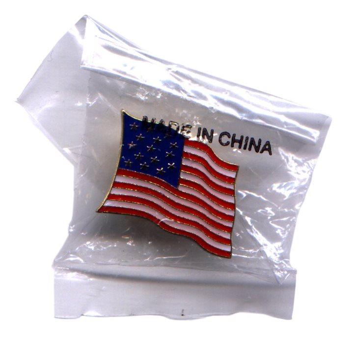 "American flag lapel pin labeled ""Made in China"""