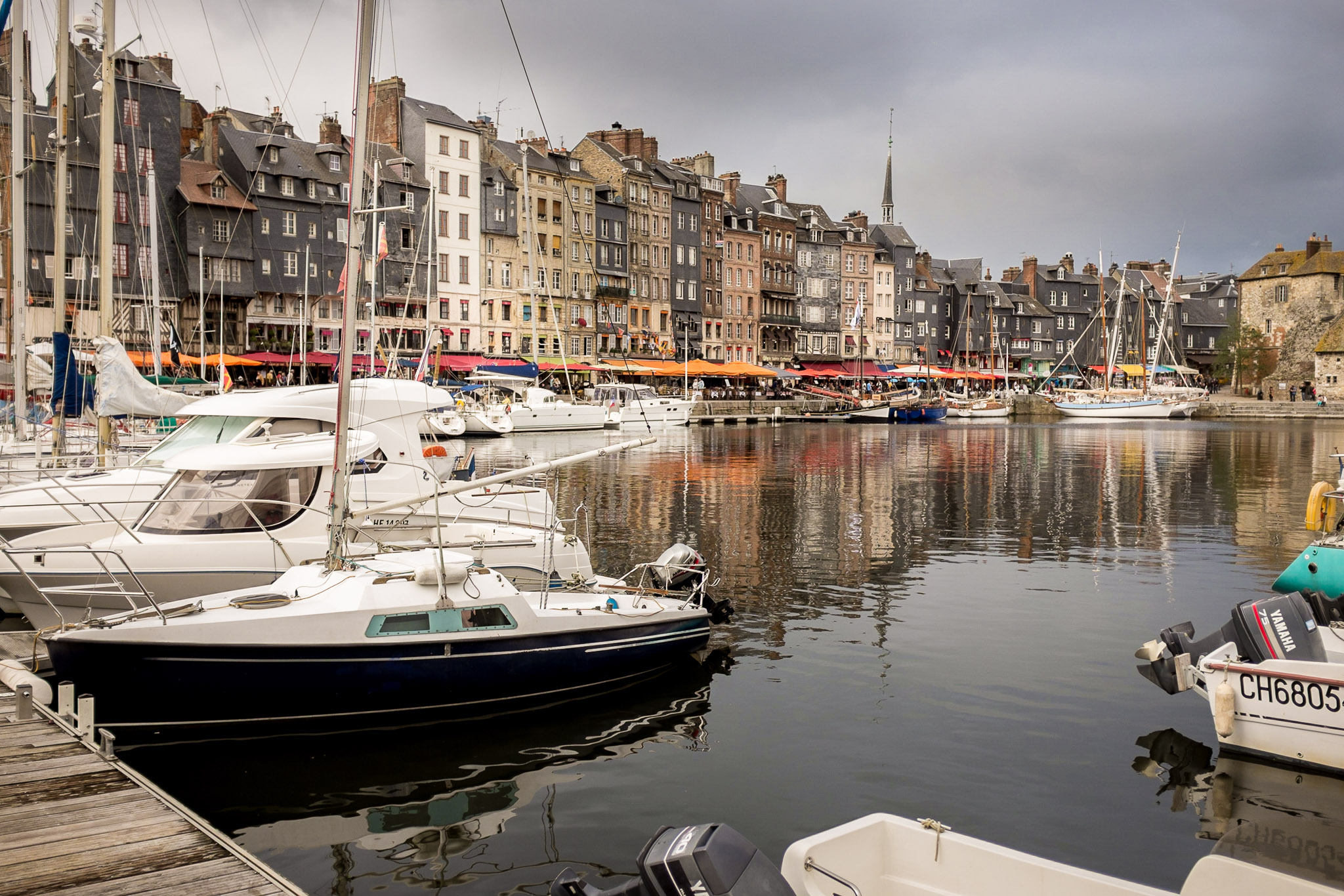 Reflections on the water of the Old Harbour in Honfleur, Normandy, France Fujifilm X100S, 1/1000 sec, ƒ2, 23mm (34 FF Equivalent), ISO200