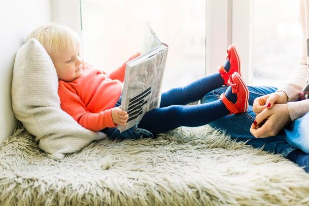 a toddler reading