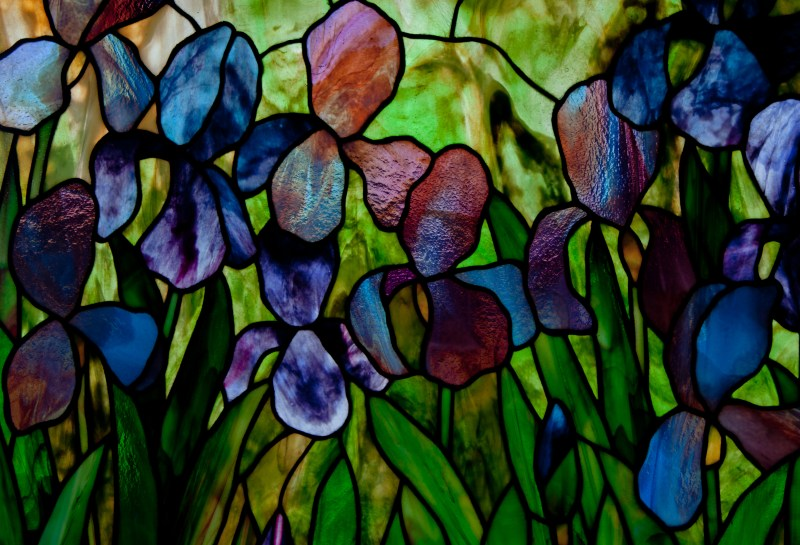 Irises at Slade Upper section close up of the stained glass panel designed by David Kennedy