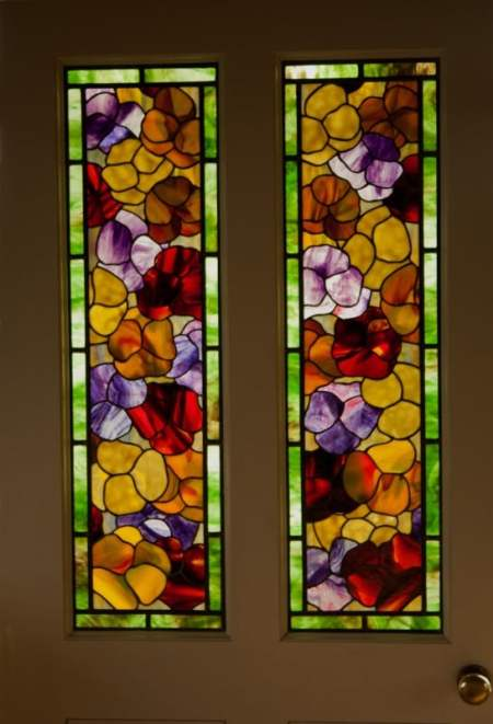 Pansies door panels, pair of panels with pansy flowers in yellow, red and violet, green glass border, designed by David Kennedy