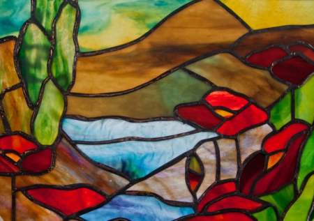 "Scene with Poppies close up of the 12"" round stained glass panel, water glass , poppies and mountains in the background"