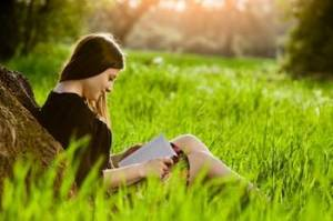 Optimized-girl reading in meadow