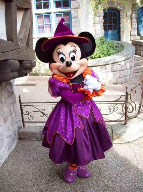 Minnie wearing her beautiful purple Halloween dress.