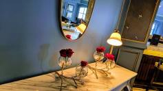 Roses and mirror at entry