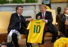 MARCH 19: Brazilian President Jair Bolsonaro presents U.S. President Donald Trump with a Brazil national soccer team jersey Number 10 for striker position at the White House March 19, 2019 in Washington, DC. President Trump is hosting President Bolsonaro for a visit and bilateral talks at the White House today. (Photo by Chris Kleponis-Pool/Getty Images)
