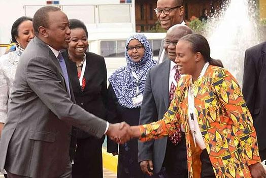 President Uhuru Shakes hand with his niece Nana in the past