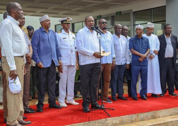 President Uhuru Kenyatta, ANC leader Musalia Mudavadi (far right) and Aden Duale (fourth left) after the head of state inaugurated the 50MW Garissa Solar Power Plant in Mbalambala, Garissa County on Friday, December 13, 2019