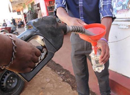 A customer purchasing kerosene at a petrol station