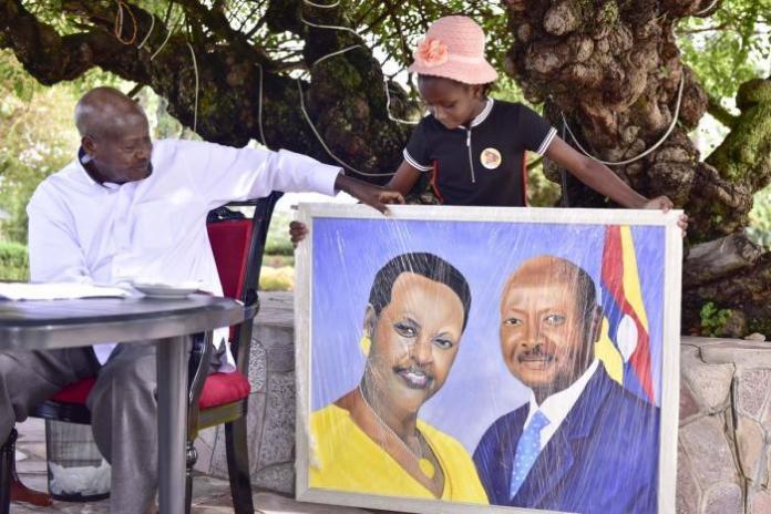 Sheldon hands Ugandan President Yoweri Museveni a portrait in April 2019