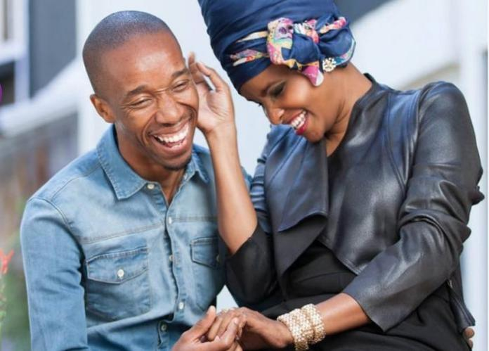 Rashid Abdalla and his wife Lulu Hassan share a hearty moment.