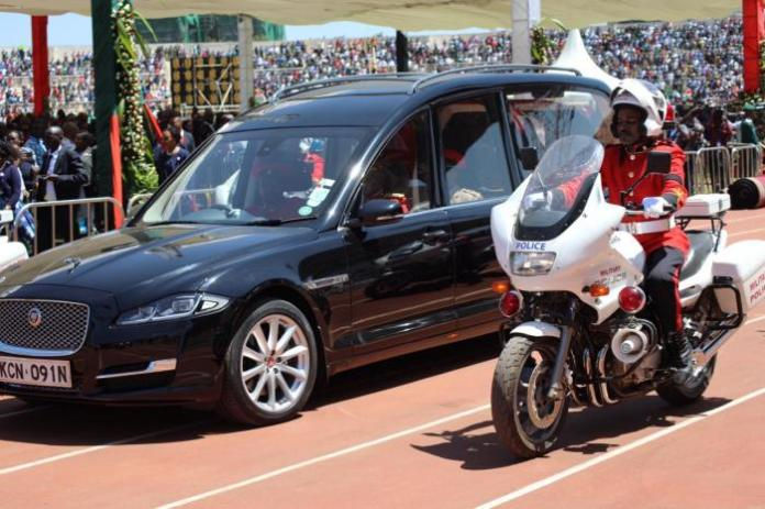 The late President Daniel arap Moi's body in a Jaguar XJ limousine on February 11 at Nyayo National Stadium.