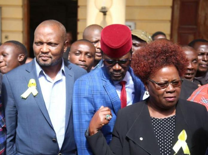 Kandara MP Alice Wahome(Right), Kimilili MP Didmus Barasa and Gatundu South MP Moses Kuria at the Milimani Law Court on January 13