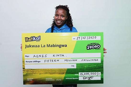 Agnes Kinya poses with her Betika Ksh15 Million dummy cheque on February 27, 2020.