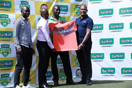 From left, Kandanda House CEO Barry Otieno, FKF Boss Nick Mwendwa and Betika Business Head John Mbatia (extreme right) handing a jersey to a Betika National Super League representative on February 24.