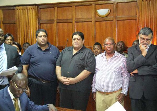 Former Imperial Bank bosses at a Nairobi court in December 2016, where they were charged with fraud