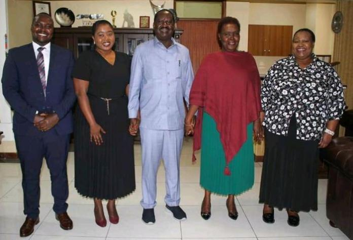 Raila during his meeting with Doris Elizabeth Chepkorir Moi, daughter of former President Daniel arap Moi and her family at his Capitol Hill office in Nairobi