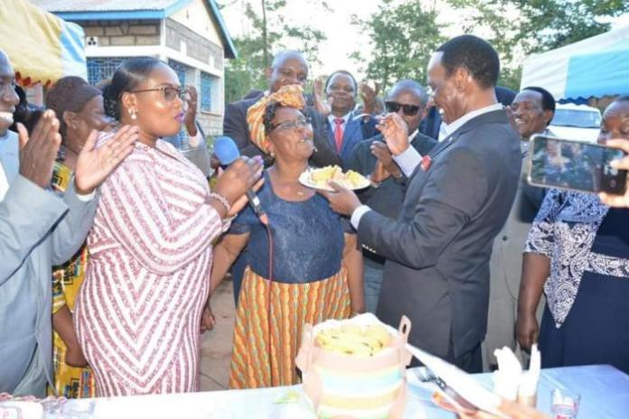 KFCB CEO Ezekiel Mutua offers cake to Esther Kavisi who settled his gown fee after he got robbed three days to graduation.