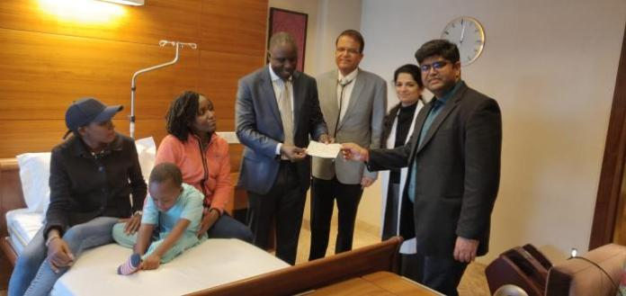 Officials of the Kenyan Embassy in Indian with Ethan Macharia and his mother Veronica Njeri at Forties Hospital, India on Friday, February 28, 2020.