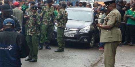 Kenya Police officers pictured at a crime scene.