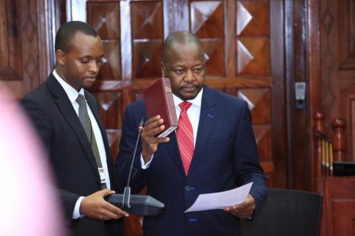 Health CS Mutahi Kagwe takes oath of office at State House on February 20, 2020.
