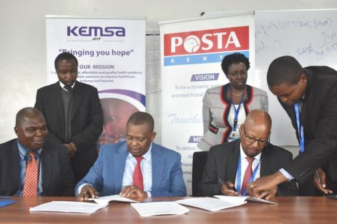 KEMSA CEO Dr. Jonah Manjari (left) with Postal Corporation of Kenya Postmaster General Mr. Dan Kagwe during the signing of partnership for countrywide delivery of Health Products and Technologies on January 14, 2020.